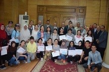 Handing the Chinese students the certificates for completing their Arabic language studies in Benha University