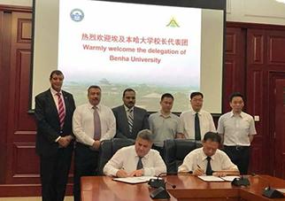القاضى يوقع الاتفاقية الثالثة مع جامعة ووهان الصينيه