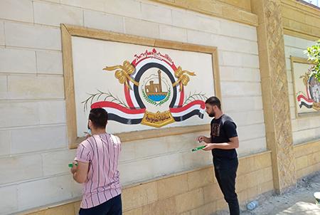 بأيدي الطلاب .. أعمال فنية لتجميل سور مستشفى بنها الجامعي